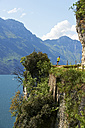 Italy, Trentino, man running at Lake Garda - MRF001466