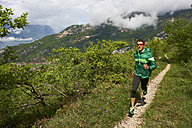 Italy, Trentino, man running near Lake Garda - MRF001518