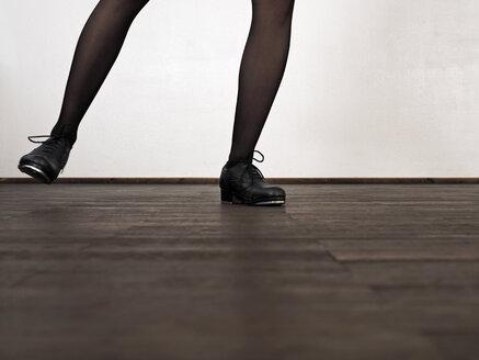 Legs of step dancing woman - LAF001292