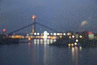 Germany, Duesseldorf, media harbor at night seen through window with raindrops - WIF001297