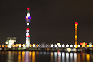 Germany, Duesseldorf, blurred view of Rhine Tower and bridge at night - WIF001304