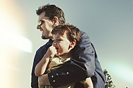 Man holding child outdoors, Cronulla, New South Wales, Australia - SBD001645