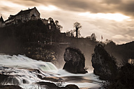 Switzerland, Schaffhausen, Rhine falls with Laufen Castle in the evening light - FCF000629