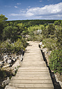 Spain, Balearic Islands, Menorca, boardwalk into the woods in Cala Macarella - RAEF000006