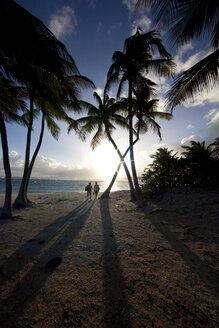 Caribbean, Guadeloupe, Grande-Terre, Sainte-Anne, tourists on the beach at sunset - WLF000014