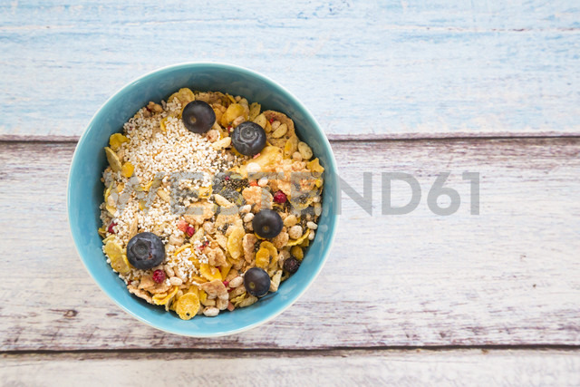 Organic chia seeds and popped amaranth, blueberries and glutenfree cereal in bowl - LVF002650
