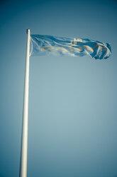 Germany, Dahme, flag with blue sky - KRPF001292
