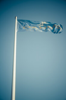 Germany, Dahme, flag with blue sky - KRPF001292