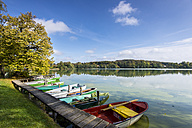 Germany, Bavaria, Lake Wesslinger in summer, jetty and rowing boats - MBOF000030