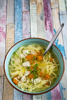 Soup bowl of chicken stock with noodles, carrots and chive - SARF001285
