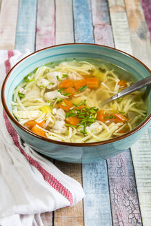 Soup bowl of chicken stock with noodles, carrots and chive - SARF001286