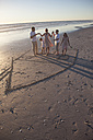 Family on beach with drawn house in the sand - ZEF004893