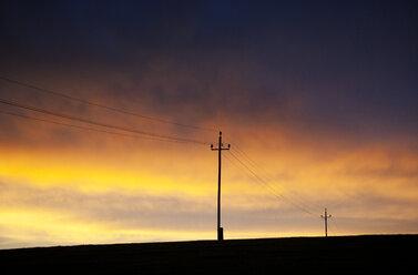 Austria, Power line against sunset sky - WWF003416