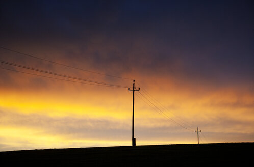 Austria, Power line against sunset sky - WWF003416