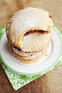 Stack of hand pies with a gooseberries and cranberry filling - HAWF000588