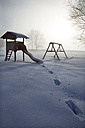 Austria, Mondsee, snow-covered playground - WWF003554