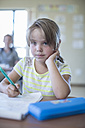 Portrait of primary schoolgirl in classroom - ZEF004982