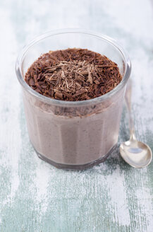 Glass of chocolate pudding with chia seeds sprinkled with chocolate shaving - ODF001082