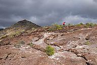 Canary Islands, La Gomera, Alajero, woman walking on hiking trail Sendero Quise - SIEF006439