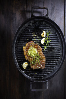 Rump steak with herbed butter, rosmary and garlic in frying pan - KSWF001412