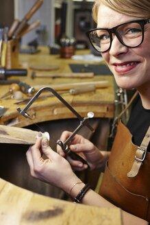 Portrait of goldsmith in workshop at work - EDF000092