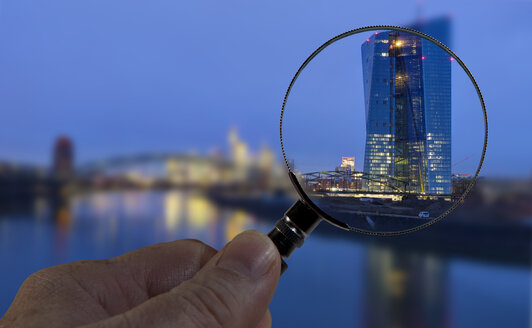 Germany, Frankfurt, European Central Bank under magnifying glass - AM003694