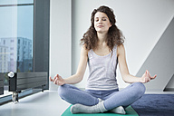 Woman in yoga position - RBF002360