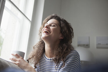 Happy young woman at home - RBF002363