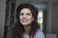 Smiling young woman at home - RBF002298