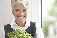 Portrait of smiling mature businesswoman - MFRF000013