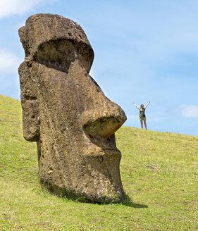 Chile, Easter Island, woman with Moai in Ranu Raraku quarry,  in the Rapa Nui National Park - GEMF000198