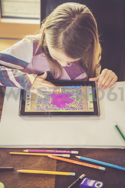 Little girl using digital tablet for drawing - SARF001308