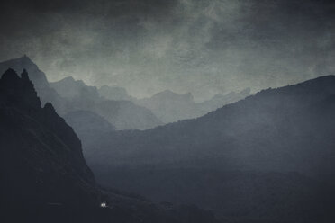 Spain, Mallorca, Cap Formentor, Mountains and road with car in the mist, textured effect - DWI000416