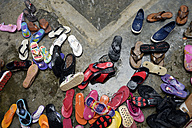 Indonesia, Aceh, Gampong Nusa, shoes in the rain in front of a community centre - FLK000574