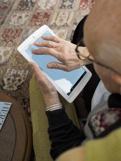 Old man at home using digital tablet - LAF001301