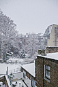 Germany, Cologne, snow-covered backyard - MFF001470