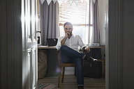 Pensive man at his home office - PDF000679