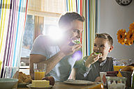 Father and son having breakfast together - PDF000752