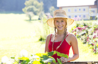 Portrait of smiling teenage girl gardening - WWF003811