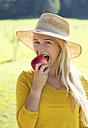 Portrait of teenage girl eating an apple - WWF003815
