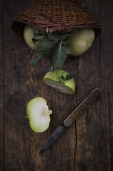 Sliced and whole kohlrabies and pocket knife on wood - LVF002775
