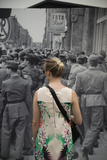 Germany, Berlin, woman standing in front of memorial plaques at Checkpoint Charlie - CHP000033