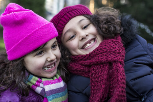 Portrait of two happy little girls in a park on a winter day - MGOF000066