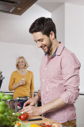 Couple cooking in kitchen - RBF002373