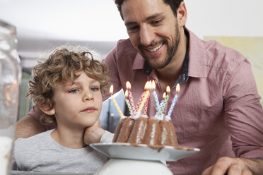 Father and son with birthday cake - RBF002425