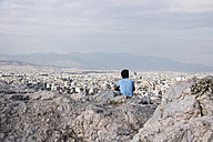 Greece, Athens, man looking on the city - CHP000027