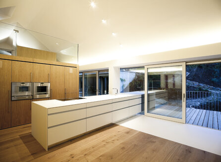 Home ownership, modern open plan kitchen in the evening - DISF001166