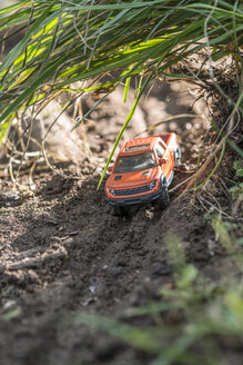 Small red off road toy car in nature - DEGF000118