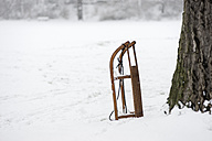 Parked sledge on snow-covered meadow - CHPF000046