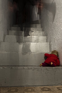 Criminal walking upstairs with doll lying on stairs - MID000061